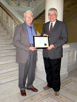 Robert H.  Dott receives the certificate of historical listing.